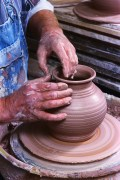 Potter Crafting Pot on Potter's Wheel